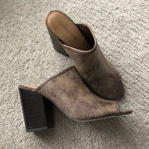 Peep toe heeled mules